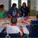Hui Malama Po`o Shriner's Service Project. Photo of children learning how to make cards.