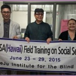 Photo of President Yang Ye Hong and Mr. Kim Chan Soo from the Jeju Institute For the Blind with AILH Executive Director, Roxanne Bolden
