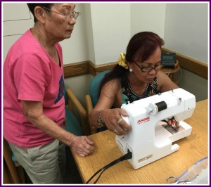 Photo of Mrs. Lum and Mary sewing
