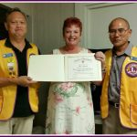 Photo of Sam with Lions Club Presidents