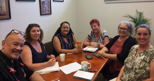Photo of Hilo staff sitting conference table