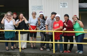Photo of staff and volunteers making silly animal poses