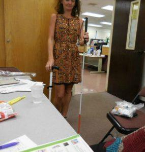 Photo of Kathleen doing white cane demo