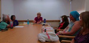 Photo of Dr. Farnham speaking to group