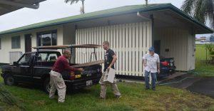Photo of men loading truck