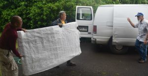 Photo of men moving bed