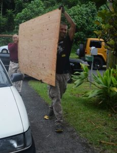 Photo of men moving plywood