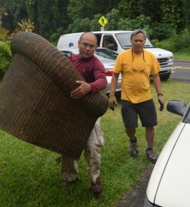 Photo of men moving furniture
