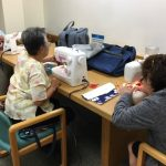 Photo of LivZen members working on sewing projects