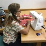 Photo of Mary sewing a happi coat