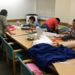 Photo of LivZen members working on projects
