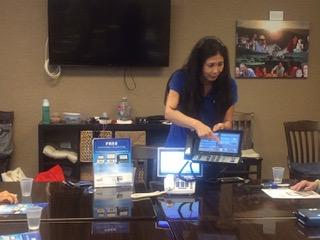 Photo of Susan Jung demonstrating CapTel phone