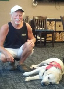 Photo of Hawaii Fi-Do consumer with his service dog