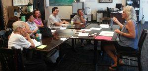 Photo of participants seated around table for Maui Hawaii Fi-Do training