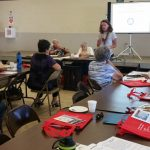 Photo of Kathleen presenting to a group of AARP members