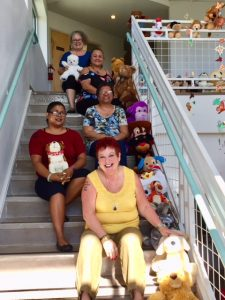 Photo of AILH staff and volunteers with stuffed animals