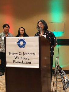 Photo of Val speaking at Weinberg Foundation Luncheon