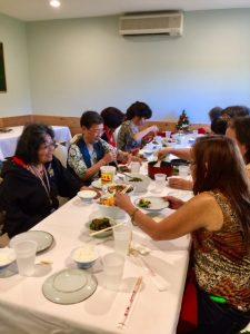Photo of Hui Members talking around table