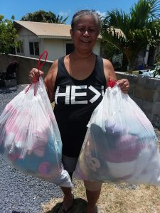 Photo of woman holding two bags full of stuffed animals