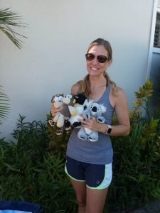 Photo of woman holding some stuffed animals