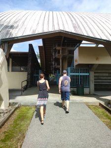 Photo of Kathleen and Rob walking towards building