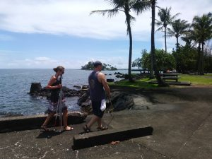 Photo of Kathleen following Rob along oceanside