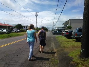 Photo of Karin following Rob on the side of the road