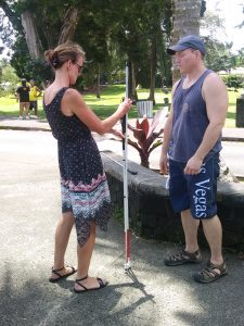 Photo of Kathleen comparing canes with Rob