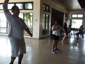 Photo of Brian, Lani, and Kathleen doing the Zumba