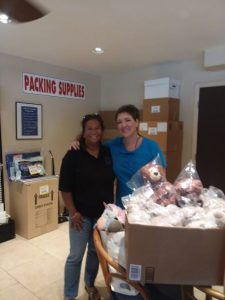 Photo of Lani picking up donation from Maui Jim's Sunglasses