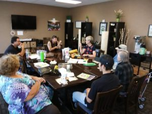 Photo of Maui Support Group meeting around conference table