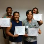 Photo of Julie, Lani, Tom, and Karin holding certificates