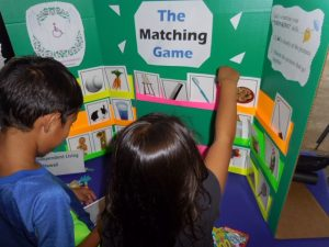Photo of two keiki playing the matching game
