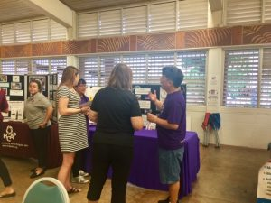 Photo of Tom talking to visitors at the AILH table