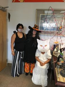 Photo of Hilo office staff dressed in Halloween costumes