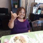 Photo of woman making shaka