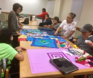 Photo of Liv Zen members working on project with fabric