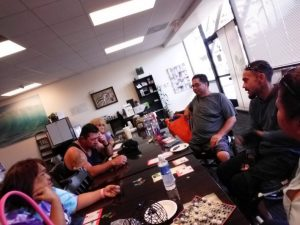 Photo of Maui support group gathered around conference table