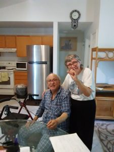 Photo of Harold and his wife in their new home