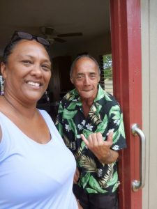 Photo of Julie and Avard standing at doorway of his new home