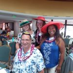 Photo of Judy Guajardo, Brian, Kathleen, and Lani wearing hats