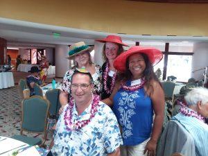 Photo of Judy Guajardo, Brian, Kathleen, and Lani wearing hats