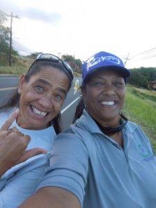 Photo of Julie and woman at charity walk